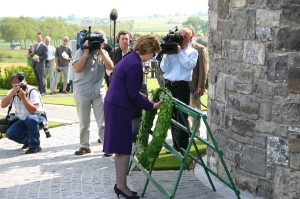 Mary McAleese, President of The Republic of Ireland, laying a wreath at the Island of Ireland Peace Park
